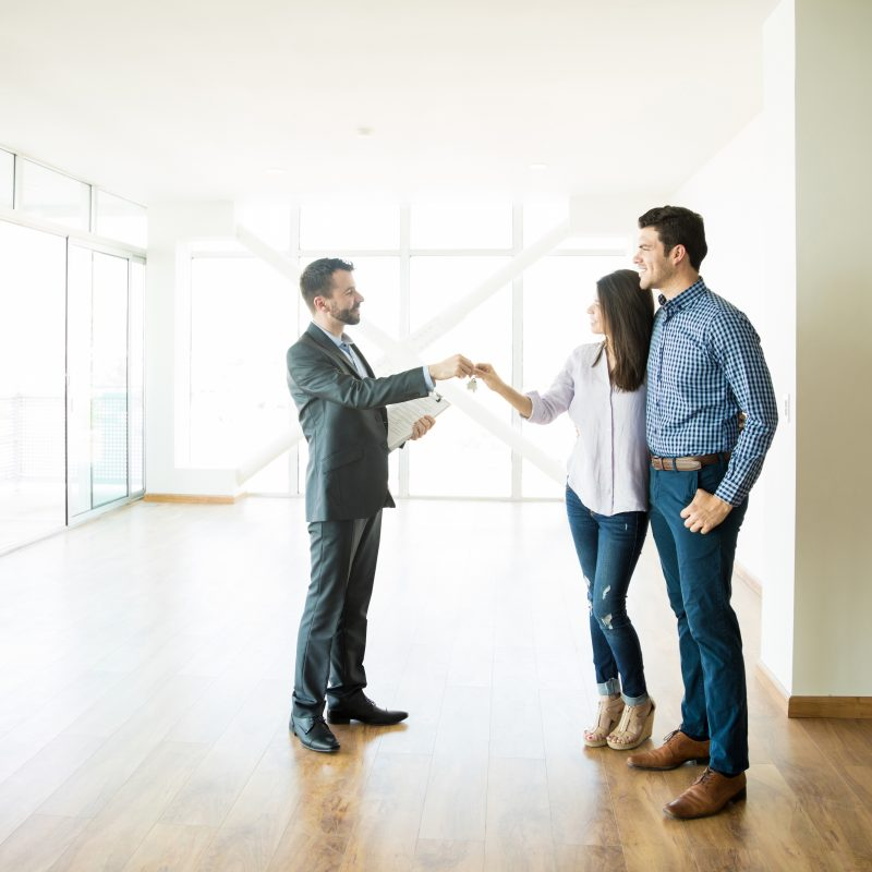 couple with a property buying agent get the keys to their home