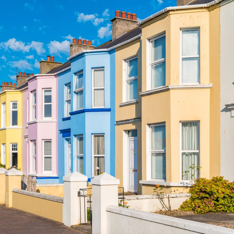 Colourful houses along a street on a sunny day.
