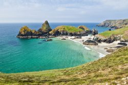 A turquoise cove with a sandy beach in beautiful Cornwall