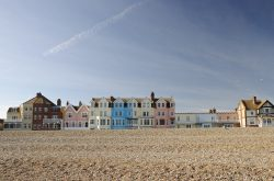 A colourful row of seafront houses in the popular coastal town of Aldeburgh, Suffolk, UK on a sunny spring day.